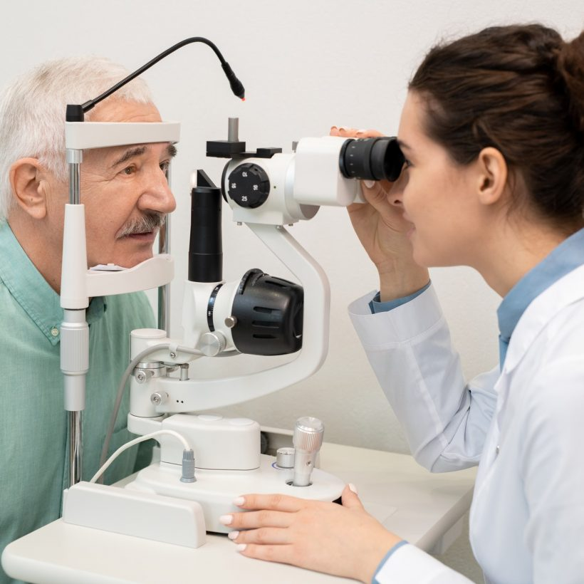 young-brunette-female-ophthalmologist-testing-eyesight-of-senior-male-patient.jpg
